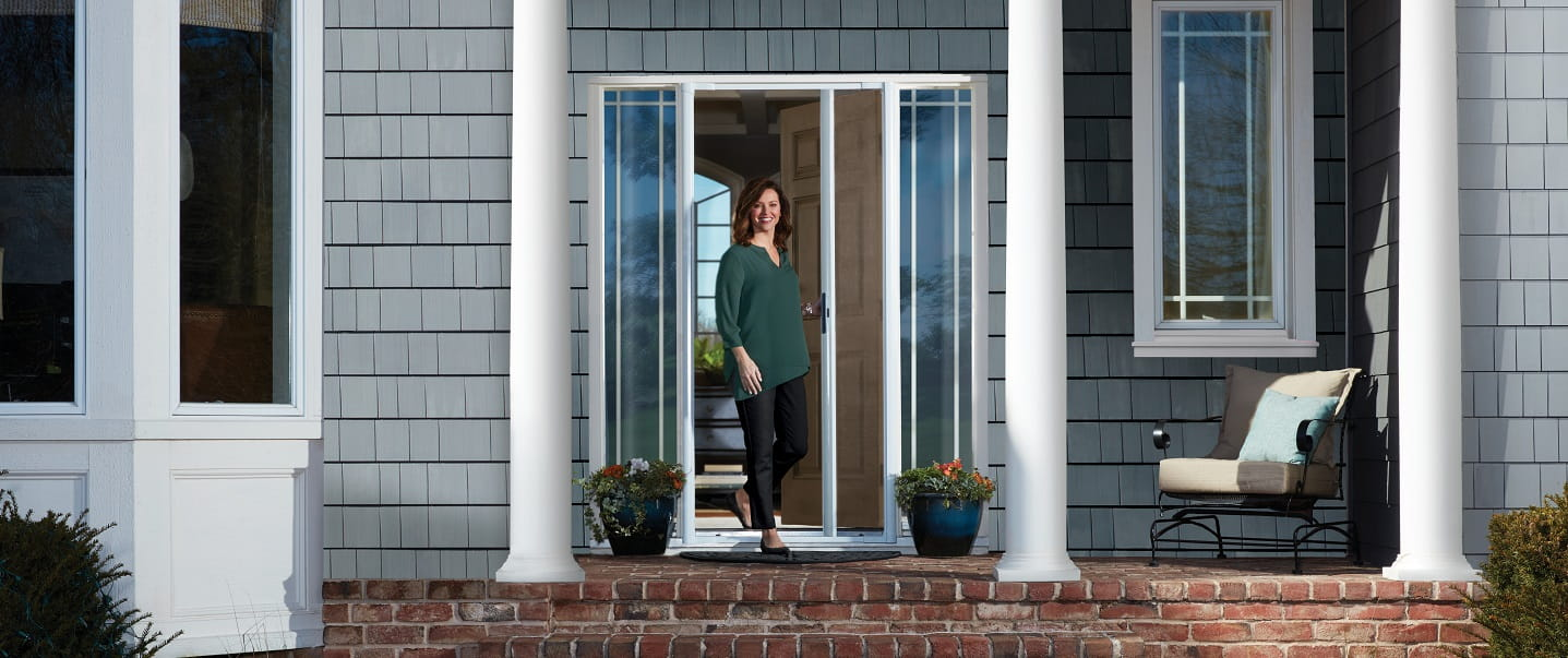 LuminAire retractable screen door from Andersen allows homeowners to instantly let natural light and ventilation into their home without changing the look of their entryway.