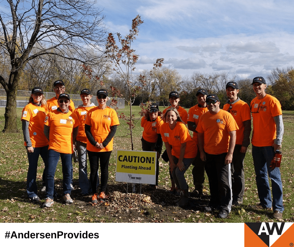 A dozen orange-clad Andersen employee volunteers eagerly helped plant 65 trees at a park in the Minneapolis suburb of Brooklyn Park