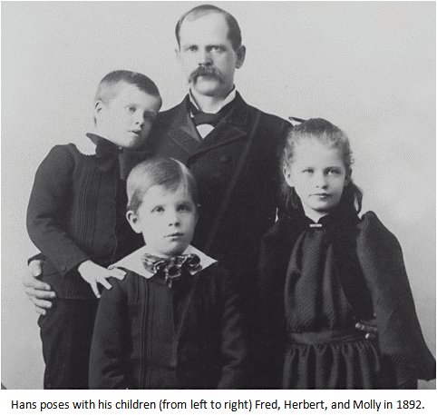 Hans Andersen poses with his children (from left to right) Fred Andersen, Herbert Andersen, and Molly Andersen. 1892