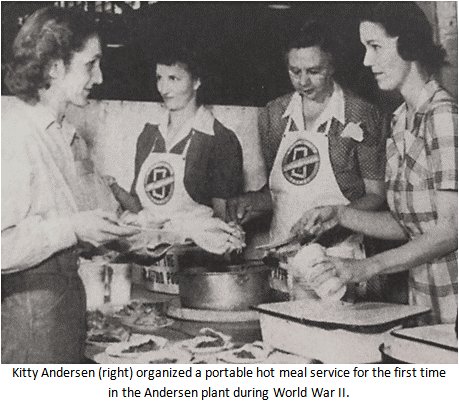 Kitty Andersen (right) organized a portable hot meal service for the first time in the Andersen manufacturing facility during World War II.
