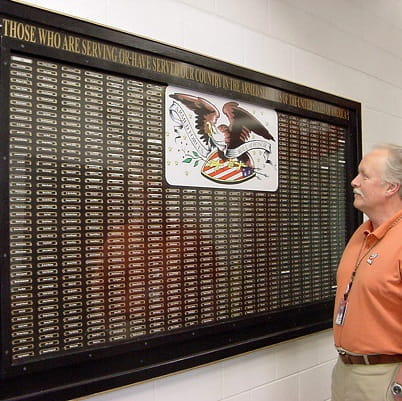 Andersen's Bayport plant honors its military veterans by placing their name on the Roll of Honor, a large, glass-enclosed plaque created in the 1940s.