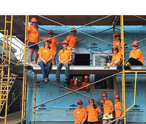 30 women representing Andersen Corporation were hard at work framing, applying foam board and house wrap, installing Andersen windows and sheathing the roof of a house at a Twin Cities Habitat for Humanity Women Build in Saint Paul, Minnesota.