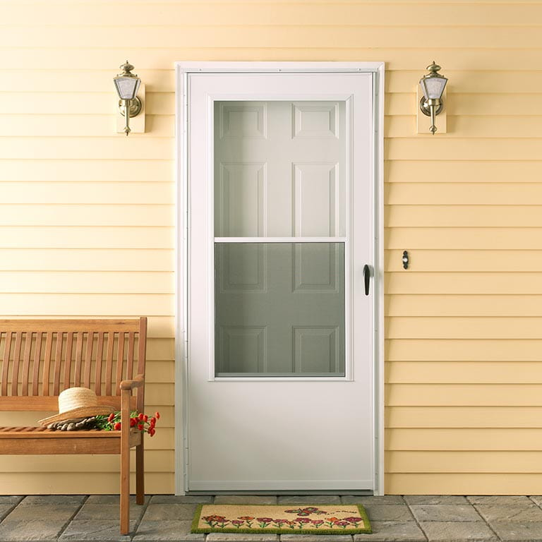 100 series self storing storm door