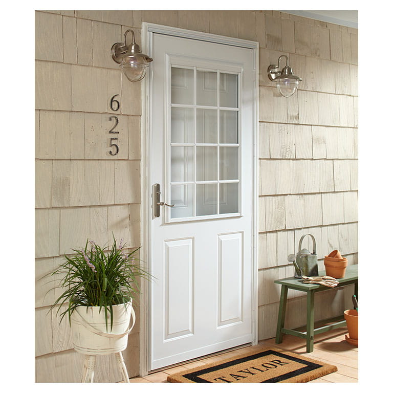Top self storing traditional colonial storm doors
