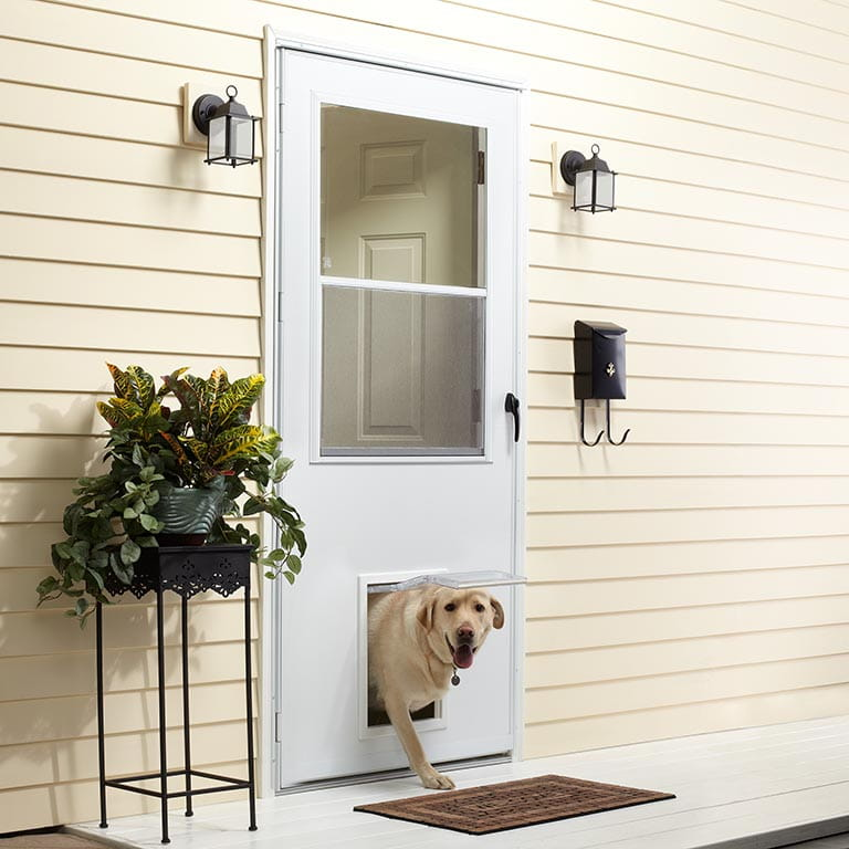 k900 self storing storm door with pet door