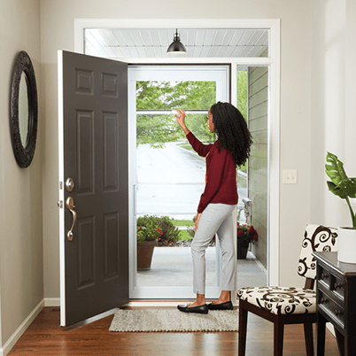 Smooth control plus storm door